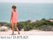 Купить «Adorable little girl have fun at tropical beach during vacation», фото № 33875821, снято 5 июля 2015 г. (c) Дмитрий Травников / Фотобанк Лори