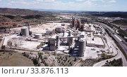 Купить «View from height at the cement plant. City Bunol. Spain», видеоролик № 33876113, снято 24 апреля 2019 г. (c) Яков Филимонов / Фотобанк Лори