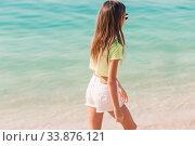 Купить «Adorable little girl have fun at tropical beach during vacation», фото № 33876121, снято 23 февраля 2020 г. (c) Дмитрий Травников / Фотобанк Лори