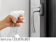 Купить «hands cleaning window handle with detergent», фото № 33876801, снято 24 апреля 2020 г. (c) Syda Productions / Фотобанк Лори