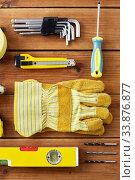 Купить «different work tools on wooden boards», фото № 33876877, снято 26 ноября 2019 г. (c) Syda Productions / Фотобанк Лори