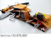 Купить «different work tools in belt on white background», фото № 33876881, снято 26 ноября 2019 г. (c) Syda Productions / Фотобанк Лори
