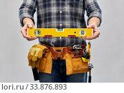 Купить «male builder with level and working tools on belt», фото № 33876893, снято 21 ноября 2019 г. (c) Syda Productions / Фотобанк Лори