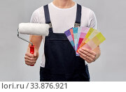 close up of painter with roller and color charts. Стоковое фото, фотограф Syda Productions / Фотобанк Лори