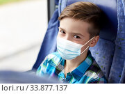 Купить «boy in mask sitting in travel bus or train», фото № 33877137, снято 21 октября 2015 г. (c) Syda Productions / Фотобанк Лори
