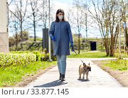 Купить «woman in mask and gloves with dog walking in city», фото № 33877145, снято 6 мая 2020 г. (c) Syda Productions / Фотобанк Лори