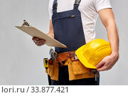 male builder with clipboard and working tools. Стоковое фото, фотограф Syda Productions / Фотобанк Лори