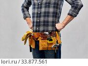 Купить «male worker or builder with working tools on belt», фото № 33877561, снято 21 ноября 2019 г. (c) Syda Productions / Фотобанк Лори