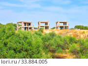 Unfinished building in the countryside in summer near Hersonissos town, Greece. Стоковое фото, фотограф Zoonar.com/Konstantin Semenov / easy Fotostock / Фотобанк Лори