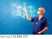 Купить «Doctor touching blue screen with full body analyze concept», фото № 33884197, снято 9 июля 2020 г. (c) easy Fotostock / Фотобанк Лори