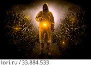 Man in raincoat at night coming from thicket and looking something with glowing lantern. Стоковое фото, фотограф Zoonar.com/rancz / easy Fotostock / Фотобанк Лори