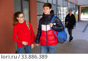 Teen girl with classmate walking to college. Стоковое фото, фотограф Яков Филимонов / Фотобанк Лори