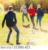 Купить «Happy teenagers playing football on green lawn», фото № 33886421, снято 10 июля 2020 г. (c) Яков Филимонов / Фотобанк Лори