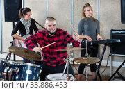 Купить «Rehearsal of music group with male drummer», фото № 33886453, снято 26 октября 2018 г. (c) Яков Филимонов / Фотобанк Лори