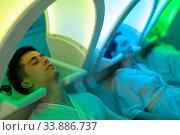 Купить «Portrait of clients resting in massage chairs for washing hair», фото № 33886737, снято 5 июня 2020 г. (c) Яков Филимонов / Фотобанк Лори