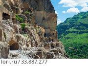 Купить «The rocky cave city of Vardzia in Georgia, a famous tourist attraction», фото № 33887277, снято 13 июня 2018 г. (c) Константин Лабунский / Фотобанк Лори