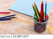 Pencils and workbooks on wooden desk. Стоковое фото, фотограф Яков Филимонов / Фотобанк Лори