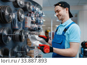 Male worker choosing disc for saw in tool store. Стоковое фото, фотограф Tryapitsyn Sergiy / Фотобанк Лори