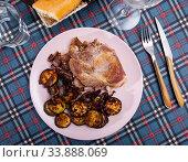 Купить «Tasty cooked fried pork with lentils at black plate», фото № 33888069, снято 10 июля 2020 г. (c) Яков Филимонов / Фотобанк Лори