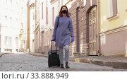 Купить «woman in protective mask with travel bag in city», видеоролик № 33888949, снято 25 мая 2020 г. (c) Syda Productions / Фотобанк Лори