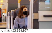 Купить «woman in protective face mask in electric train», видеоролик № 33888957, снято 25 мая 2020 г. (c) Syda Productions / Фотобанк Лори