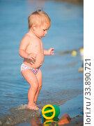Купить «Baby playing on the sandy beach and in sea water. Cute little kid with toys on sand tropical beach. Ocean coast.», фото № 33890721, снято 7 августа 2020 г. (c) easy Fotostock / Фотобанк Лори