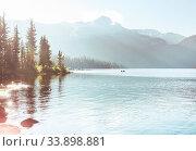Купить «Serene scene by the mountain lake with reflection of the rocks in the calm water.», фото № 33898881, снято 2 июня 2020 г. (c) easy Fotostock / Фотобанк Лори