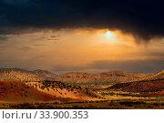 Купить «The dry desert land of the western USA under a stormy colored sky.», фото № 33900353, снято 2 июня 2020 г. (c) easy Fotostock / Фотобанк Лори