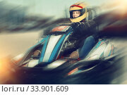 Купить «Woman driving sport car for karting in a circuit lap outdoor in», фото № 33901609, снято 18 марта 2019 г. (c) Яков Филимонов / Фотобанк Лори