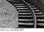 Купить «Grungy turning rail on dark wooden sleepers», фото № 33902037, снято 29 июня 2019 г. (c) EugeneSergeev / Фотобанк Лори