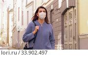 Купить «woman wearing medical mask walking in city», видеоролик № 33902497, снято 28 мая 2020 г. (c) Syda Productions / Фотобанк Лори