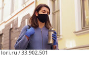Купить «woman in mask with tumbler walking in city», видеоролик № 33902501, снято 28 мая 2020 г. (c) Syda Productions / Фотобанк Лори