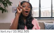 Купить «happy female video blogger talks to camera at home», видеоролик № 33902505, снято 24 мая 2020 г. (c) Syda Productions / Фотобанк Лори