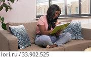 Купить «woman with diary sitting on sofa at home», видеоролик № 33902525, снято 24 мая 2020 г. (c) Syda Productions / Фотобанк Лори