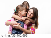 Купить «Две сестры и мама счастливо обнимаются, изолировано на белом фоне», фото № 33902693, снято 15 мая 2020 г. (c) Иванов Алексей / Фотобанк Лори