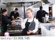 Upset waitress in kitchen of restaurant. Стоковое фото, фотограф Яков Филимонов / Фотобанк Лори