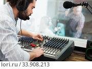 Купить «Male sound engineer at work», фото № 33908213, снято 16 марта 2019 г. (c) Яков Филимонов / Фотобанк Лори