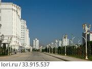 Купить «Wide boulevard with some new buildings. Ashkhabad. Turkmenistan.», фото № 33915537, снято 13 июля 2020 г. (c) age Fotostock / Фотобанк Лори
