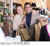 Купить «Couple is satisfied shopping», фото № 33918853, снято 12 марта 2018 г. (c) Яков Филимонов / Фотобанк Лори