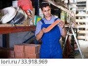 Купить «Seller is checking quality of tiles», фото № 33918969, снято 26 июля 2017 г. (c) Яков Филимонов / Фотобанк Лори