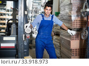 Купить «Portrait of young man assistant in building shop», фото № 33918973, снято 26 июля 2017 г. (c) Яков Филимонов / Фотобанк Лори