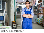 Portrait of smiling man in uniform on his workplace in building store. Стоковое фото, фотограф Яков Филимонов / Фотобанк Лори