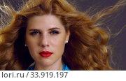 Купить «Slow motion flying hair and woman face with red lips», видеоролик № 33919197, снято 29 декабря 2019 г. (c) Gennadiy Poznyakov / Фотобанк Лори