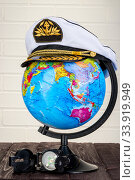 captain hat, globe and compass around the world travel concept. Стоковое фото, фотограф Константин Лабунский / Фотобанк Лори