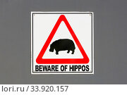 Sign warning about hippos, KwaZulu-Natal, South Africa. Стоковое фото, фотограф Richard Du Toit / Nature Picture Library / Фотобанк Лори