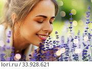Купить «close up of woman smelling lavender flowers», фото № 33928621, снято 12 июля 2019 г. (c) Syda Productions / Фотобанк Лори