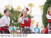 Купить «People in traditional folk Bulgarian costumes», фото № 33928937, снято 6 июля 2018 г. (c) Nataliia Zhekova / Фотобанк Лори