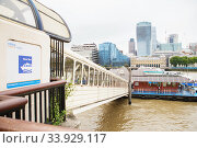 LONDON - AUGUST 21, 2017: City Cruises tour boat on River Thames. City view from the Thames river. Редакционное фото, фотограф Nataliia Zhekova / Фотобанк Лори