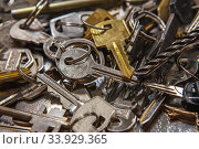A Pile of old Keys different shapes and colors. Many vintage keys. Стоковое фото, фотограф Nataliia Zhekova / Фотобанк Лори