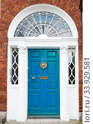 A blue door in Dublin, Ireland (2019 год). Стоковое фото, фотограф Nataliia Zhekova / Фотобанк Лори